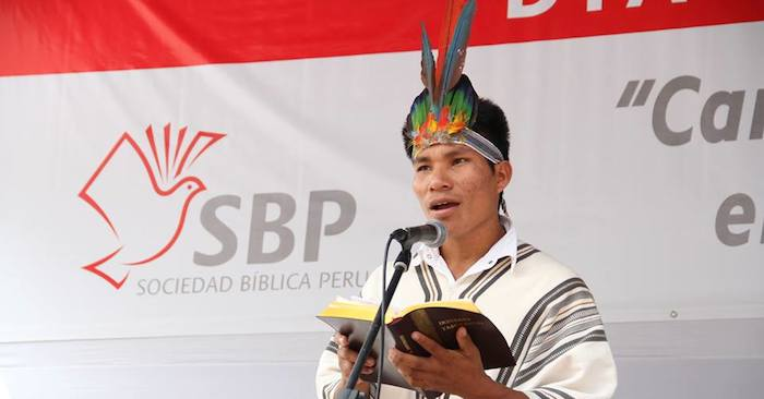 An indigenous Bible translator reads from the Bible he helped translate.