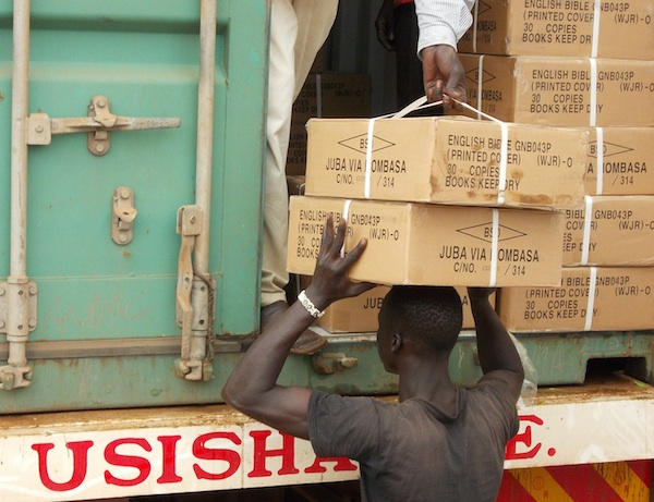 South Sudan youth unloading Scriptures