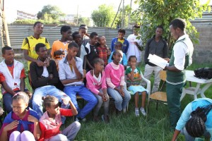 Groum reading to orphans from the Amharic Bible
