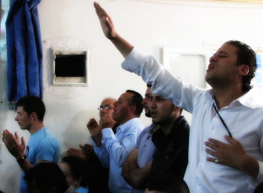 Whole-hearted worship in a Kabyle church.