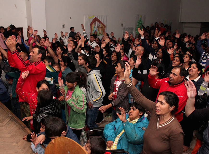 A church, bursting at its seams with Roma worshippers