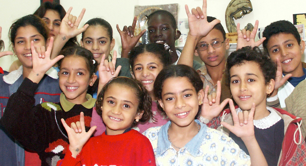 Deaf children in Egypt, who enjoy Bible story books in Egyptian sign language.