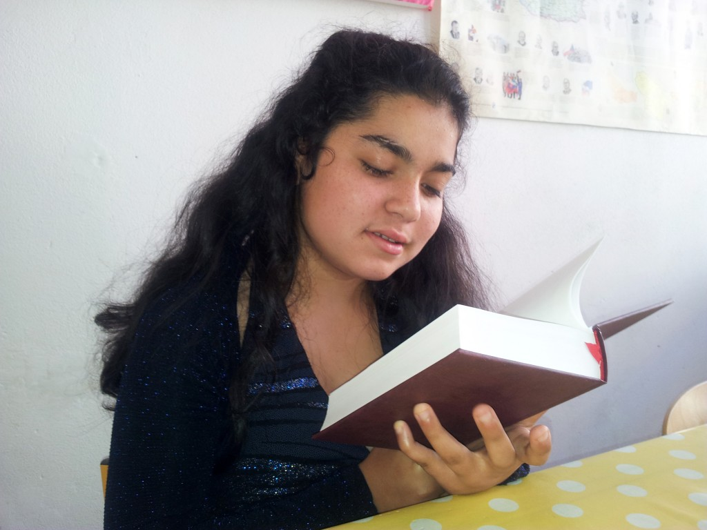 A Roma schoolgirl with her new Bible