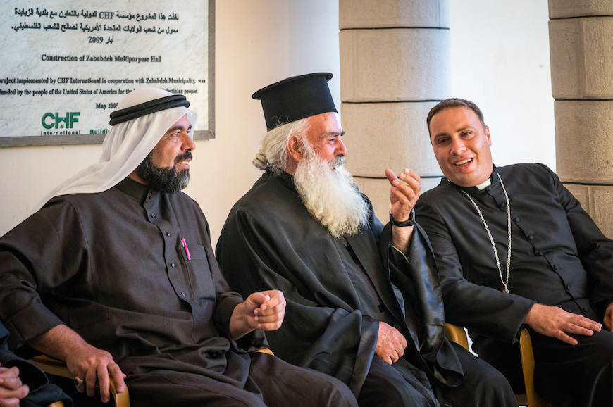 Sheikh Imad, Imam of the main mosque in Zababdeh (left), Father Tomeh from the Greek Orthodox Church and Rev Salim from the Anglican Church were among the many religious leaders who enjoyed dinner together.