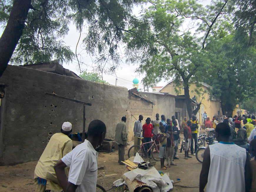 People standing around in shock at the site of the second suicide bomb attack in Maroua.