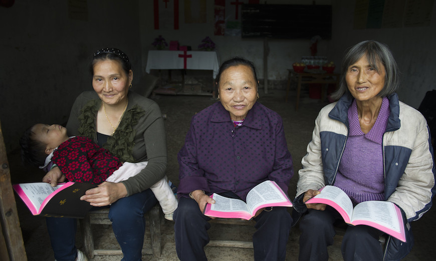 The little church in Luo Shui has grown to 70 members, thanks to Wu Qiang Jin (centre), who is described as a 'born evangeliser'. Li Yue Ying (left) and Wu Xiu Ying (right) are some of the many who became Christians through her.