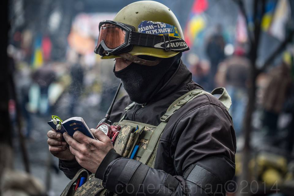A protester in Ukraine's Maidan Square in early 2014 reads from a book of Psalms. Photo © Sodel Vlad