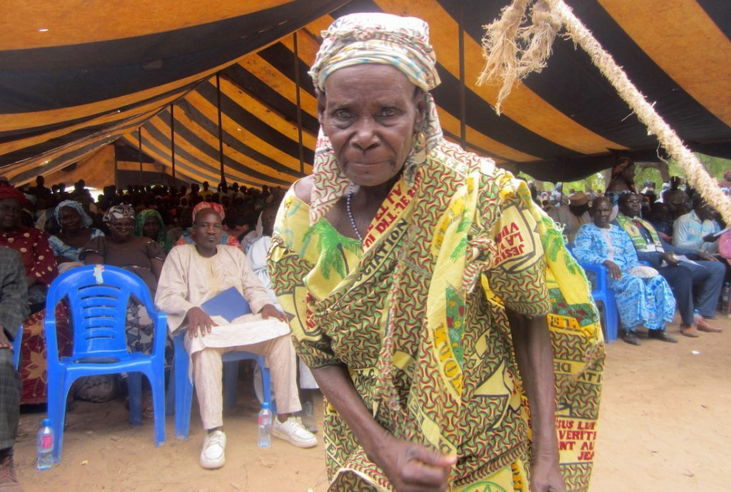 An elderly lady dancing at the launch of the Musgum Bible.