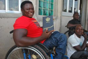 Abraham Adole with his Tiv Bible