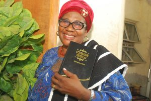 Aguveren Uza with her new Tiv Bible