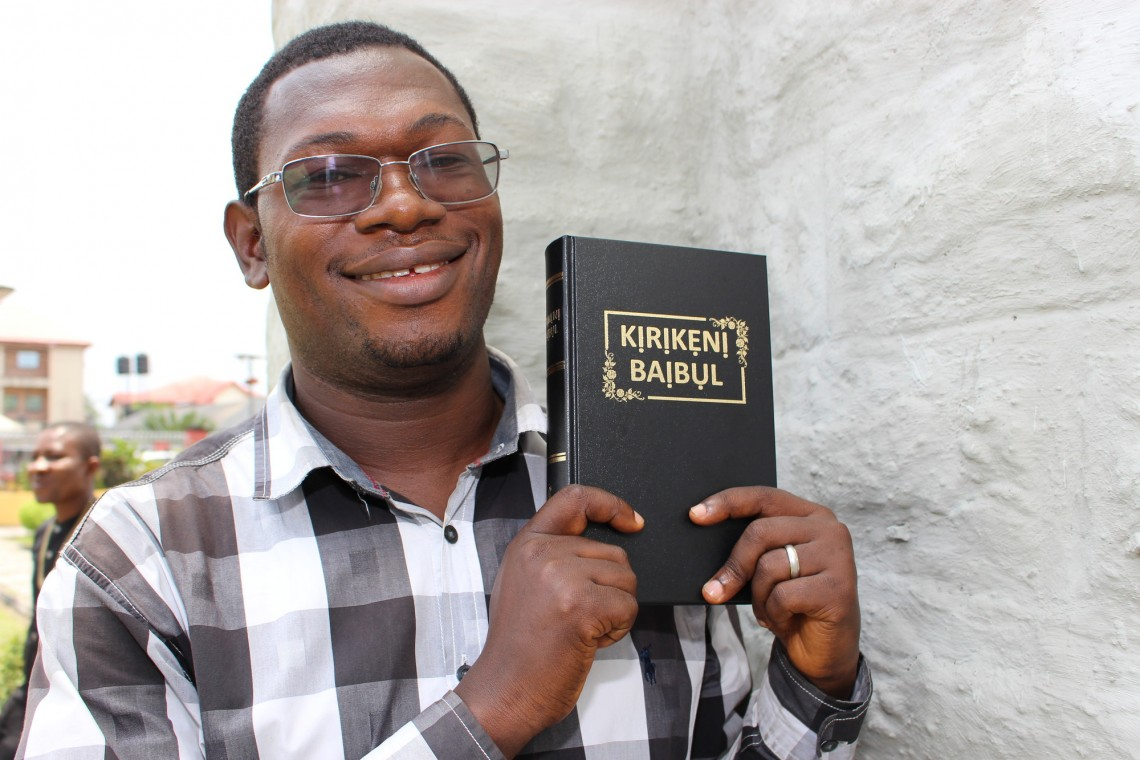 David Ogan holding the first Okrika Bible