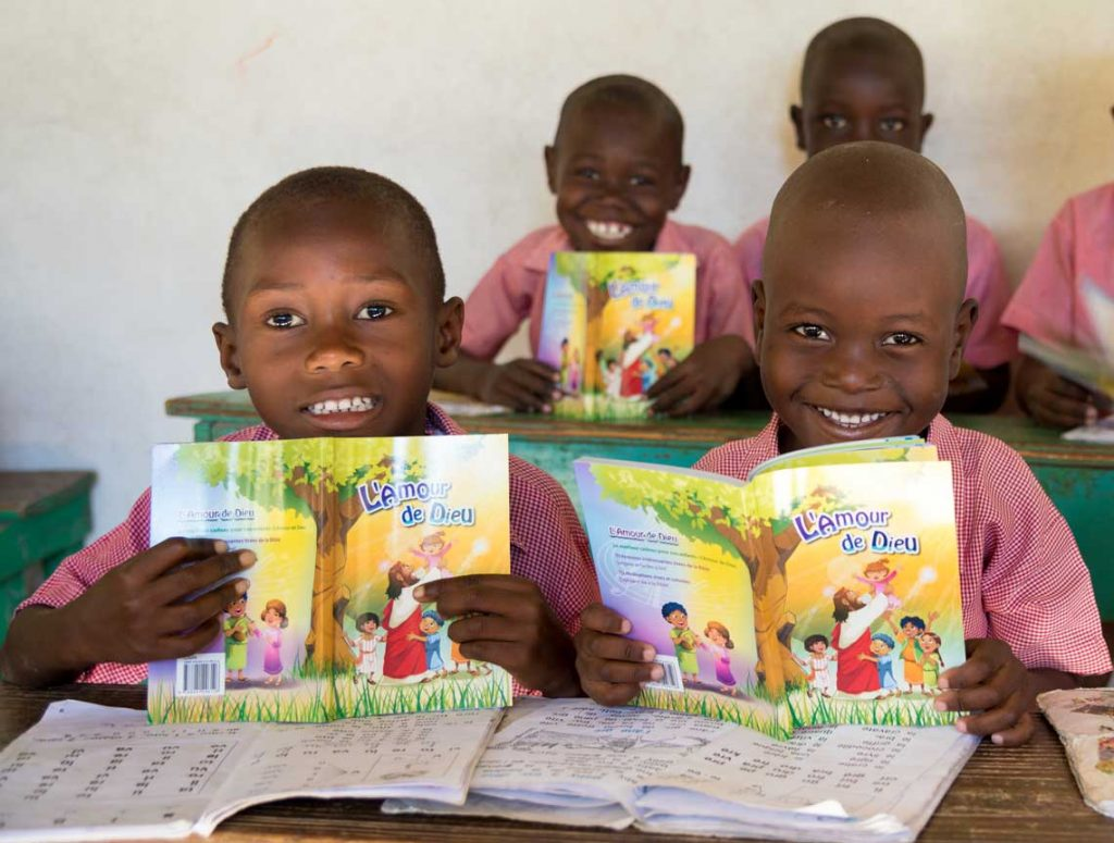 Haitian children with their new Scriptures.